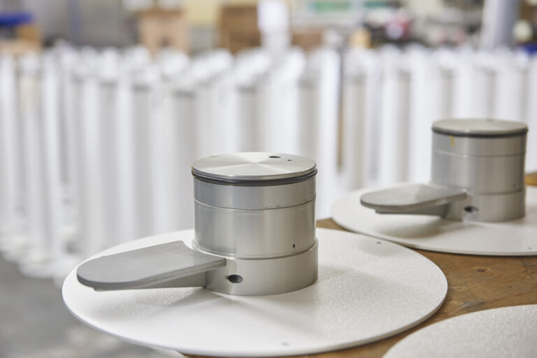XtraSafe Sanitizer Dispenser pedal units lined up in SafeGuard facility