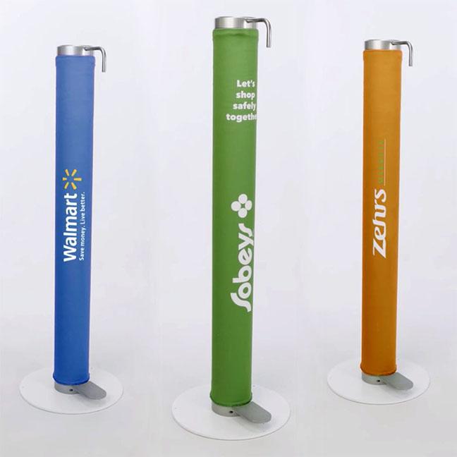 Three XtraSafe Sanitizer Dispenser mockups with branded nylon sleeves